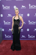 http://img204.imagevenue.com/loc568/th_703354862_Kaley_Cuoco_48th_Annual_Academy_Country_Music_Awards7_122_568lo.jpg